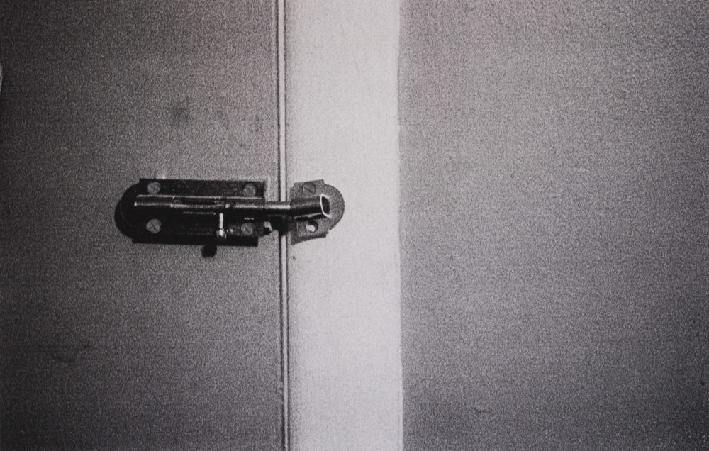 Broken Doorknob = Lock, 2020. Black and White Film (with flash). 11 x 14 in. 3D Pen.